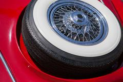 Close up of spare tire on an red retro car - stock photo