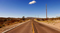 Long and empty road through Arizona desert . Stock Footage
