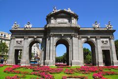 Madrid Puerta de Alcala with flower gardens Stock Photos
