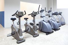 Elliptical cross trainer, stationary bicycle treadmill Stock Photos