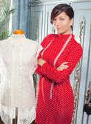Dressmaker with mannequin working at home - stock photo