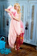 Fashion vintage blond housewife cleaning mop chores Stock Photos