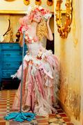 Stock Photo of baroque fashion blonde housewife woman mop chores