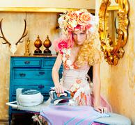 baroque fashion blonde housewife woman iron chores - stock photo