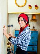 Diy fashion woman with nail and hammer - stock photo