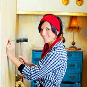Diy fashion woman with nail and hammer - stock photo