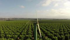 Farmland flyover windmill lemon grove wind machine citrus protection control Stock Footage
