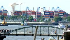 4K Germany Port of Hamburg OOCL Container ship leaving Harbour Harbor Dock Wharf Stock Footage