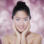 Chinese woman with light glitter background Stock Photos