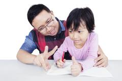 Dad teach his daughter to count - stock photo