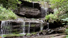 Cascading waterfall mountain rocks Stock Footage