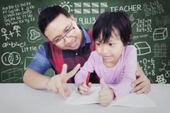 Male teacher teach his student to calculate - stock photo