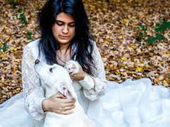 Latina teen with dog and rat - stock photo