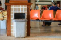 Trash bin at transport station. Stock Photos
