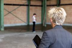 Business woman is inspecting a warehouse - stock photo