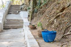 Blue plastic basket use as trashcan. - stock photo