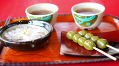 Video of Japanese Kyoto traditional sweets dessert set, dango and green tea Stock Footage