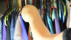 Selecting a shirt 1 Stock Footage