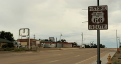 4K Time Lapse cars drive by Historic Route 66 road sign Santa Rosa, New Mexico Stock Footage
