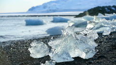 Ice blocks melting at a glacier lagoon in Iceland - stock footage