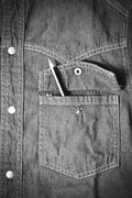Stock Photo of pencil in jean pocket black and white tone color style