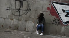Upset depressed unhappy girl aimlessly sitting alone, slow motion. Stock Footage
