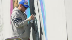 Street artist painting with a spray bottle Stock Footage