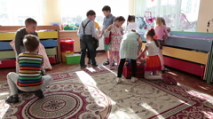 Cute boys and girls play toys on the floor of classroom. Russia Stock Footage