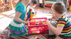 Playroom in nursery school with playing kids Stock Footage