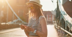 Woman using smartphone in the European city. Slow Motion. Travel. Lens flare. Stock Footage