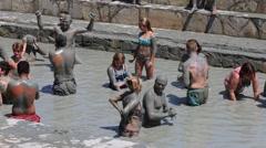 Men and women are taking a mud bath . Dalyan, Turkey Stock Footage