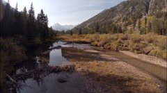 Fly Fisherman in Idaho Mountain River Aerial Stock Footage