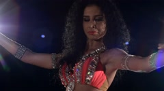Beautiful european sexy woman belly dancer`s movements on black, back light - stock footage