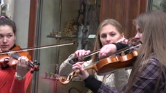 Young teenagers group play violin in free street event. 4K Stock Footage
