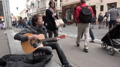 Self taught street musician play guitar and mouthorgan . 4K Stock Footage