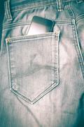 Smart phone in jean pocket retro vintage style Stock Photos
