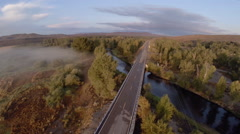 Aerial Car on Scenic Highway over River Forward Bird Stock Footage