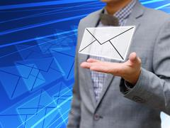 Stock Photo of Businessman got email
