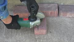Man cuts a detail of  red brick with grinder, 4K Stock Footage