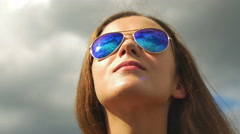 6 in 1 video! Woman watch through glasses at clouds by the blue sky background Stock Footage
