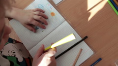 Children have a drawing lesson in day-care center. Russia - stock footage