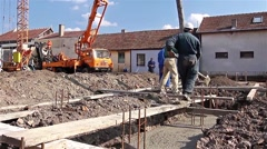 Team of construction workers are working on concreting at construction site. Stock Footage