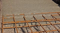 Concrete is spreading in foundation over reinforcing steel bars. Stock Footage