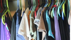 hanging shirt in closet - stock footage