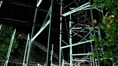 Rollercoaster. The roller coaster ride on a dark afternoon. Stock Footage