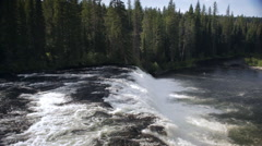 Large Waterfall Flows into Idaho River Stock Footage