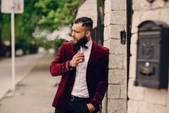 Bearded man with e-cigarette Stock Photos