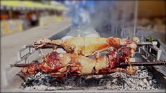 Lambs are roasting on a spit. Stock Footage