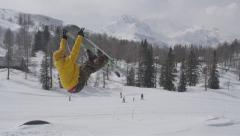 AERIAL SLOW MOTION: Freestyle skier jumping big kicker in snowpark - stock footage