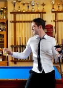 Billiard handsome young man with shirt cue and tie - stock photo